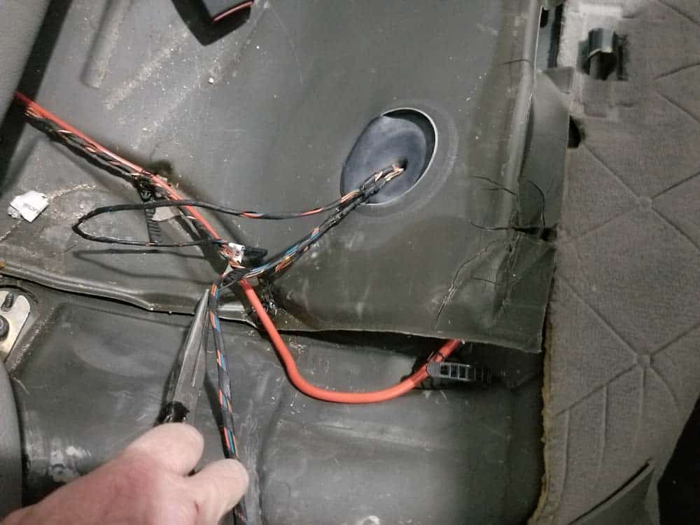 Unsnap any wiring harnesses around the fuel pump