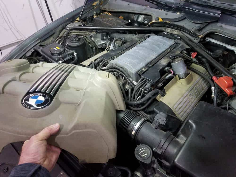 bmw n62 thermostat replacement - Remove the upper engine cover from the vehicle.