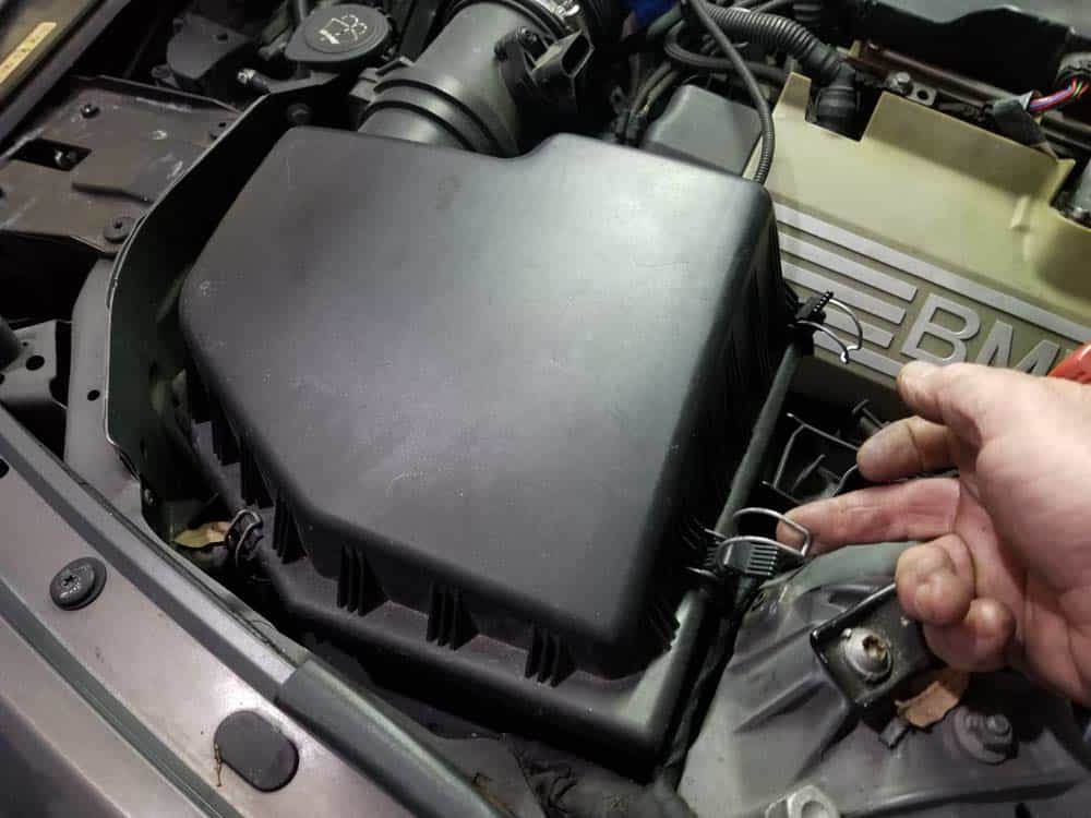 bmw n62 thermostat replacement - Unsnap the intake muffler cover.