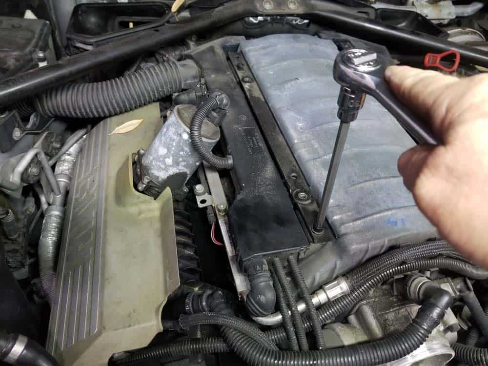 bmw n62 intake manifold gasket replacement - Use a T30 torx bit to remove the four bolts securing the wiring harness to the engine