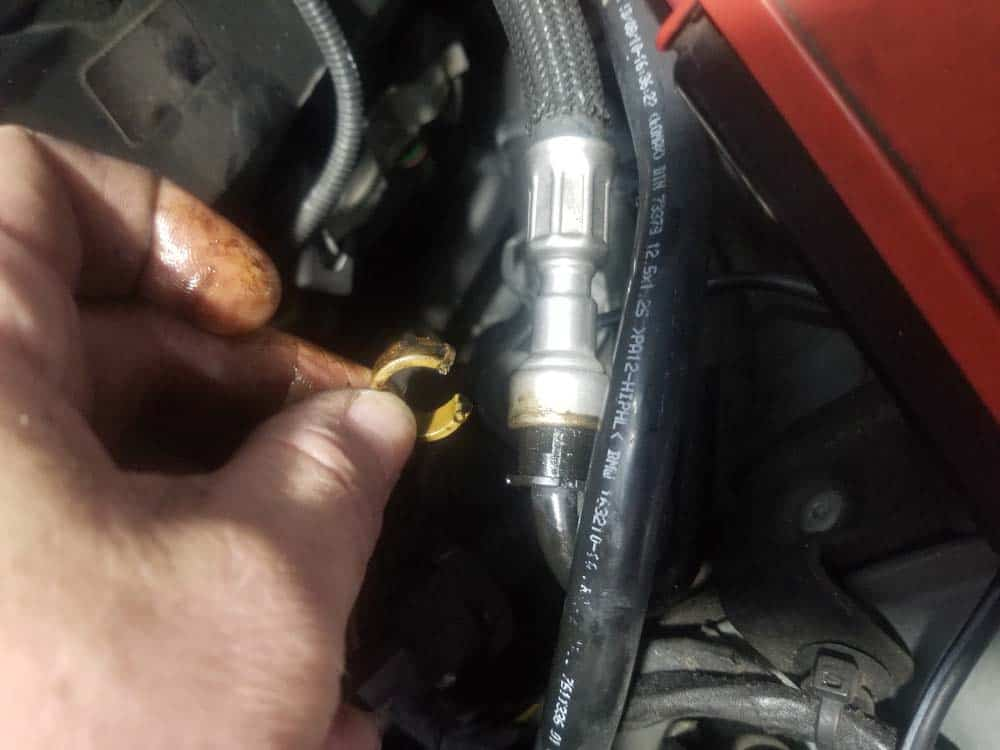 Remove the plastic locking collar from the fuel line connection
