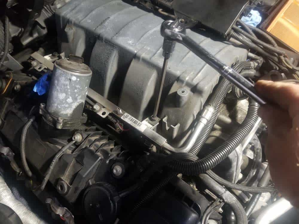 bmw n62 intake manifold gasket replacement - Remove the two fuel rail mounting bolts on the right side of the engine