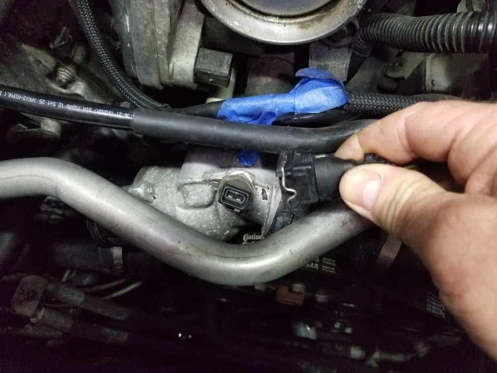 Unplug the coolant temperature sensor