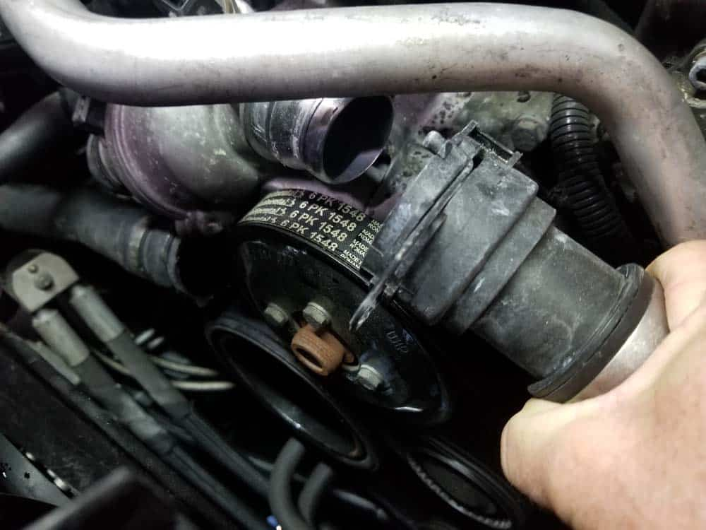 bmw water pump replacement - Remove the coolant return hose from the water pump