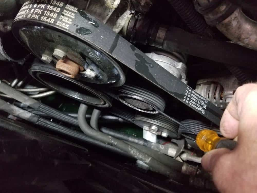 bmw water pump replacement - Remove the dust cap from the tensioner pulley
