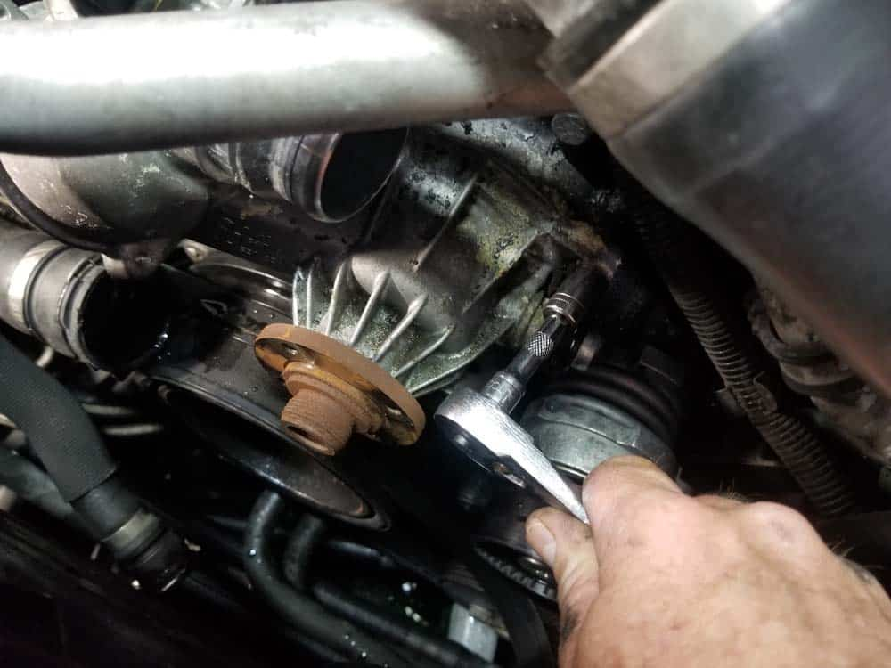 bmw water pump replacement - Remove the upper four mounting bolts from the water pump
