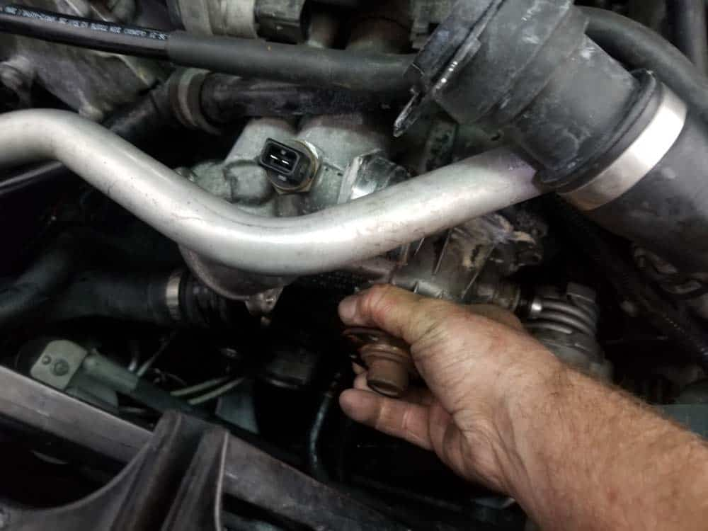 bmw water pump replacement - Grasp the water pump and pull it loose from the engine block