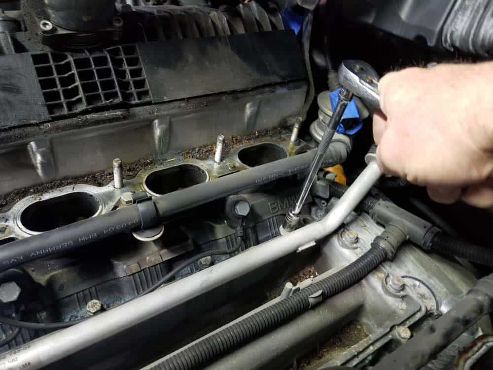 bmw n62 valley pan replacement - Remove the 10mm bolts anchoring the valley pan to the engine