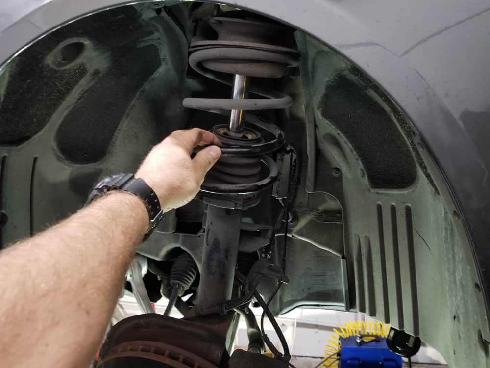 Lower the front strut out of the vehicle