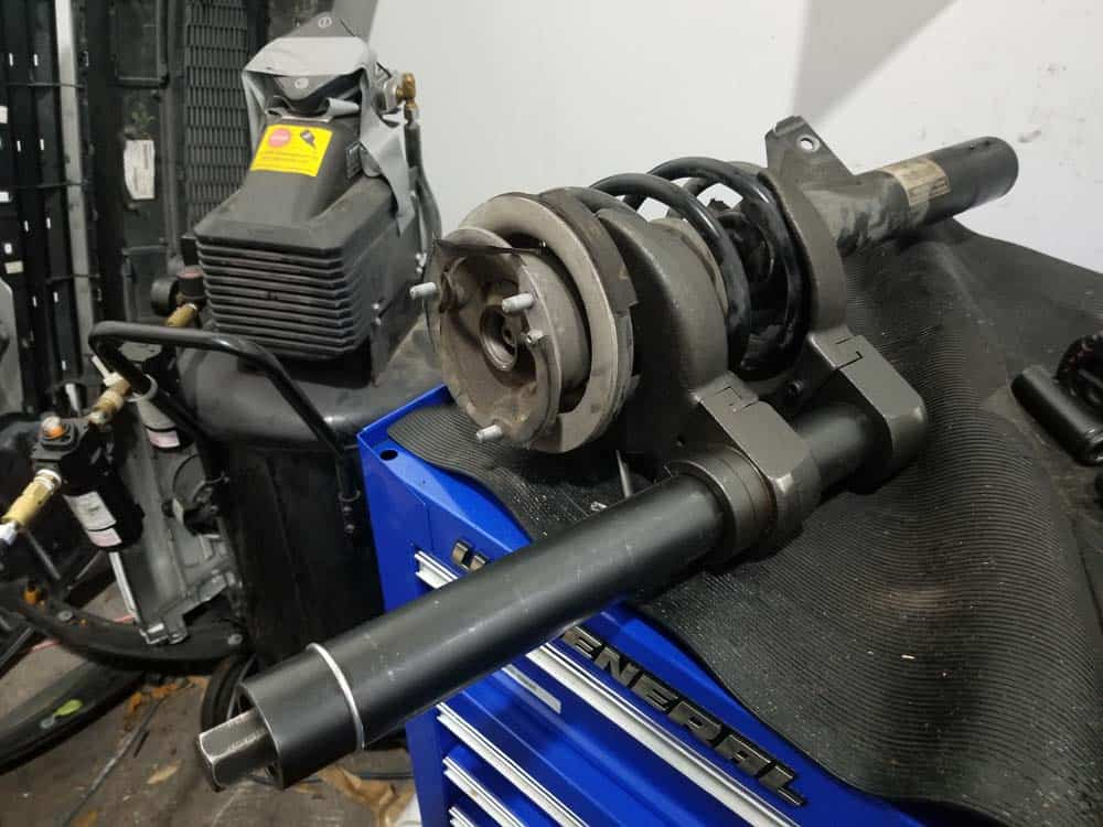 bmw e60 front strut replacement - Use a plate style spring compressor to compress the spring