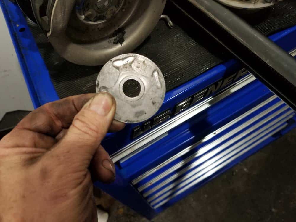 Note the orientation of the strut washer