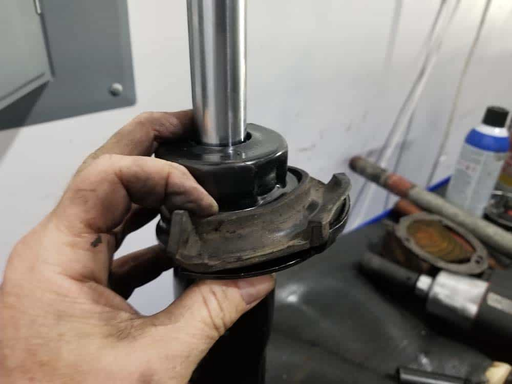 bmw e60 front strut replacement - installing the lower spring pad