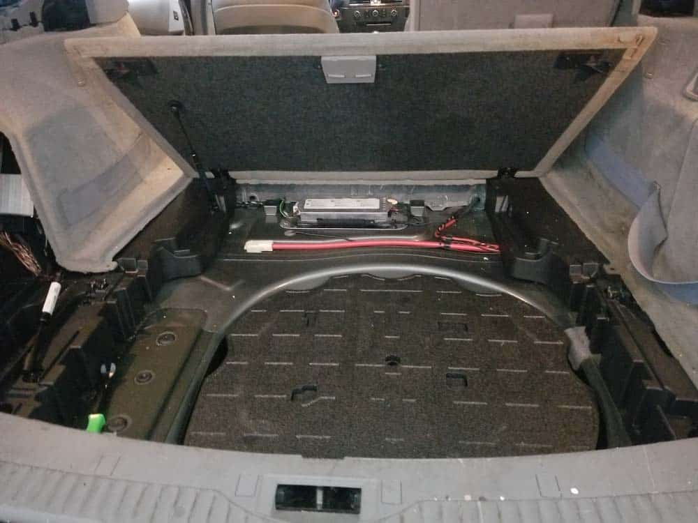 Remove the trunk storage floor from the vehicle