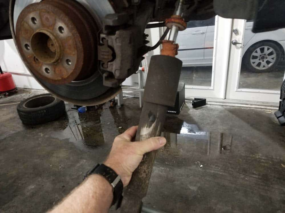 bmw e61 rear shock replacement - Remove the rear shock from the vehicle