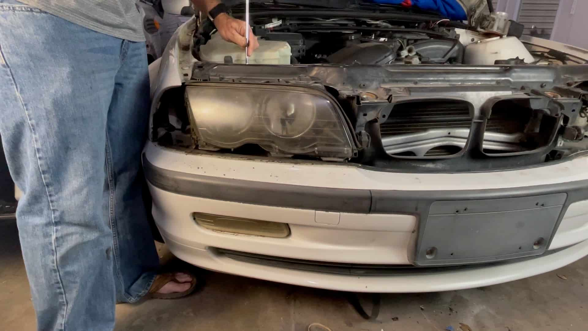 bmw e46 headlight removal - Remove the second lower mounting screw