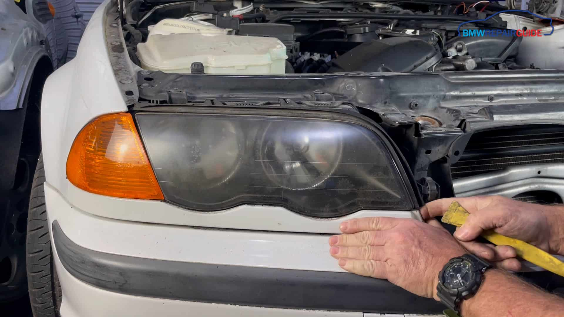 bmw e46 headlight removal - Pry the lower trim loose with a plastic trim removal tool