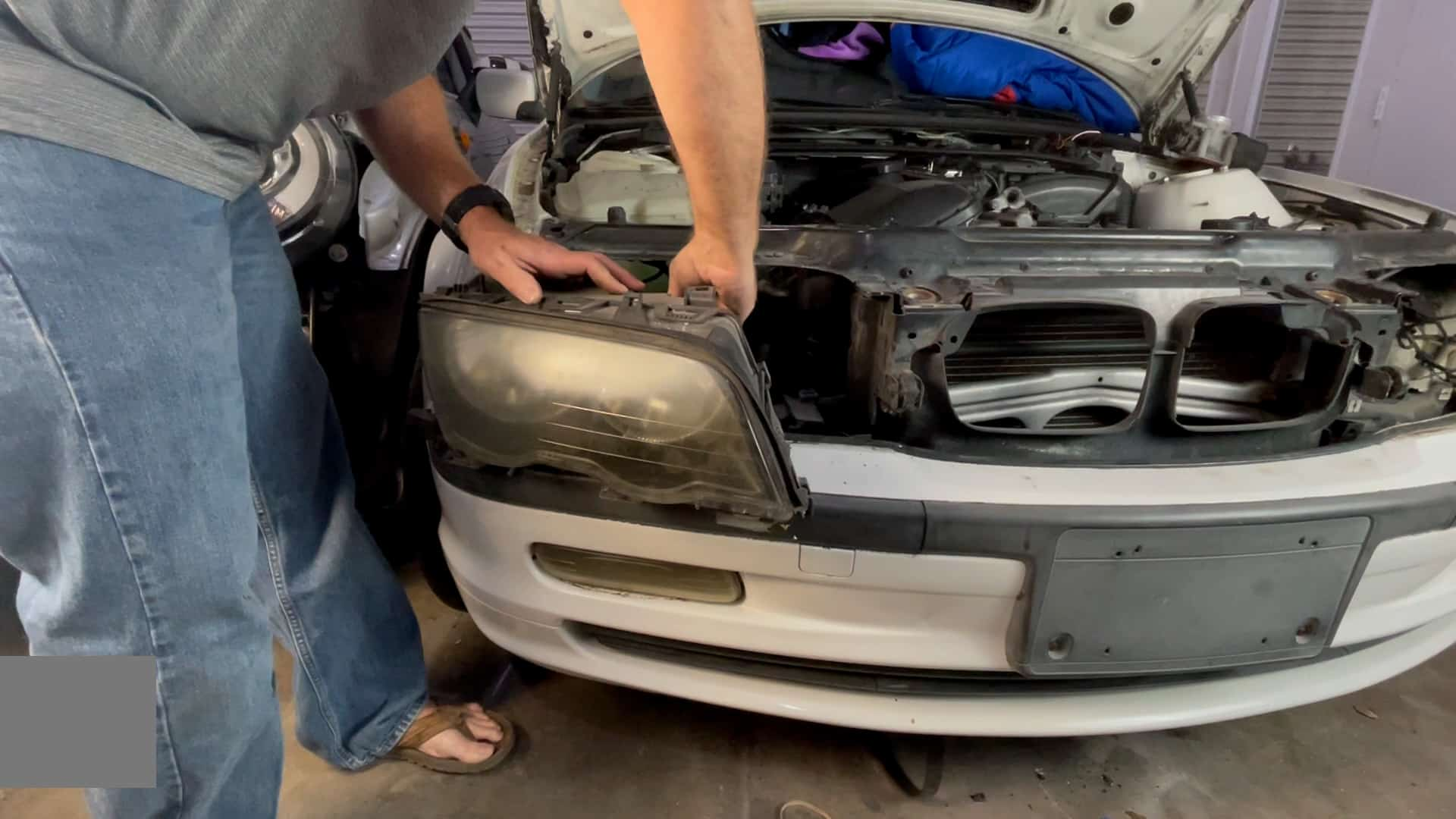 bmw e46 headlight removal - Unplug the bulbs and remove the headlight from the vehicle