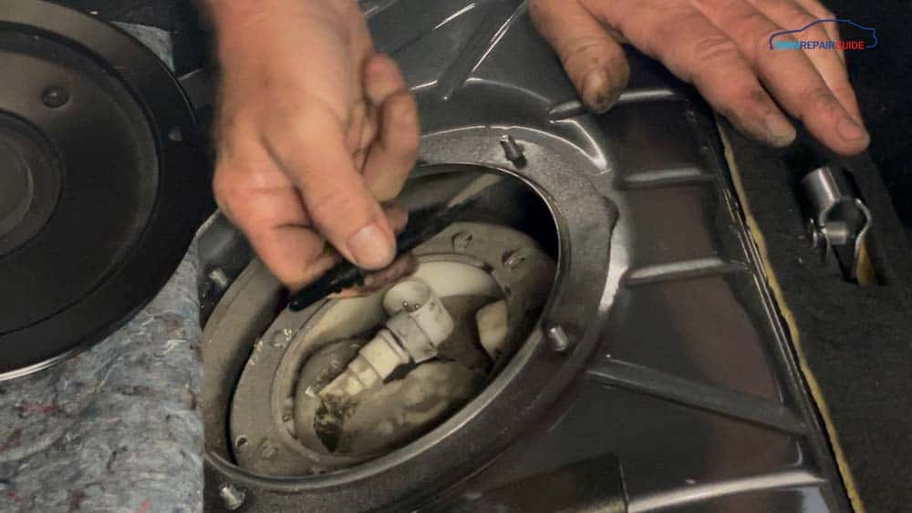 bmw e90 fuel pump replacement - Remove the fuel line from the fuel filter