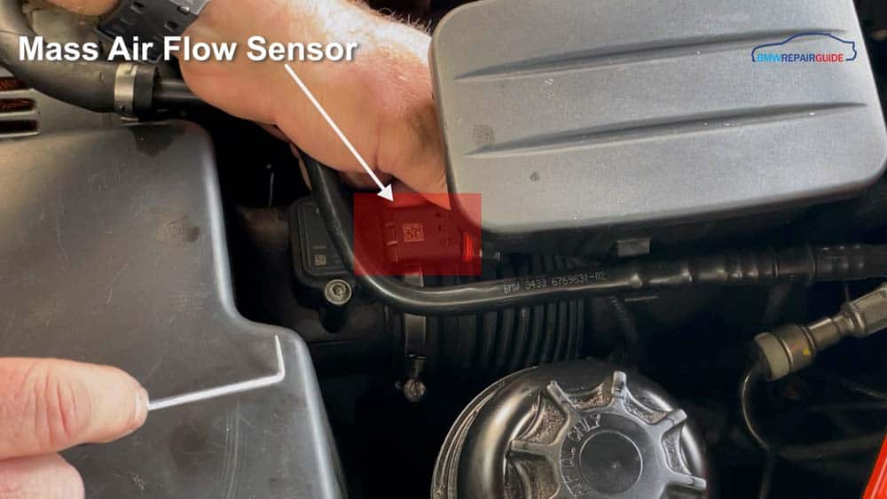 Locate the mass air flow sensor on the intake pipe