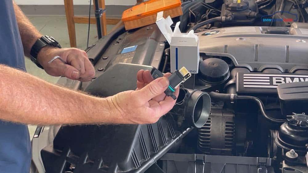 bmw n52 mass air flow sensor repair - Remove the mass air flow sensor from the vehicle
