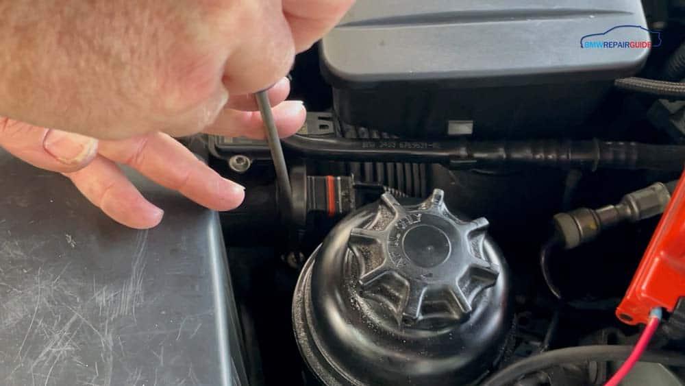 bmw n52 mass air flow sensor repair - Loosen the intake pipe hose clamp with a flat blade screwdriver