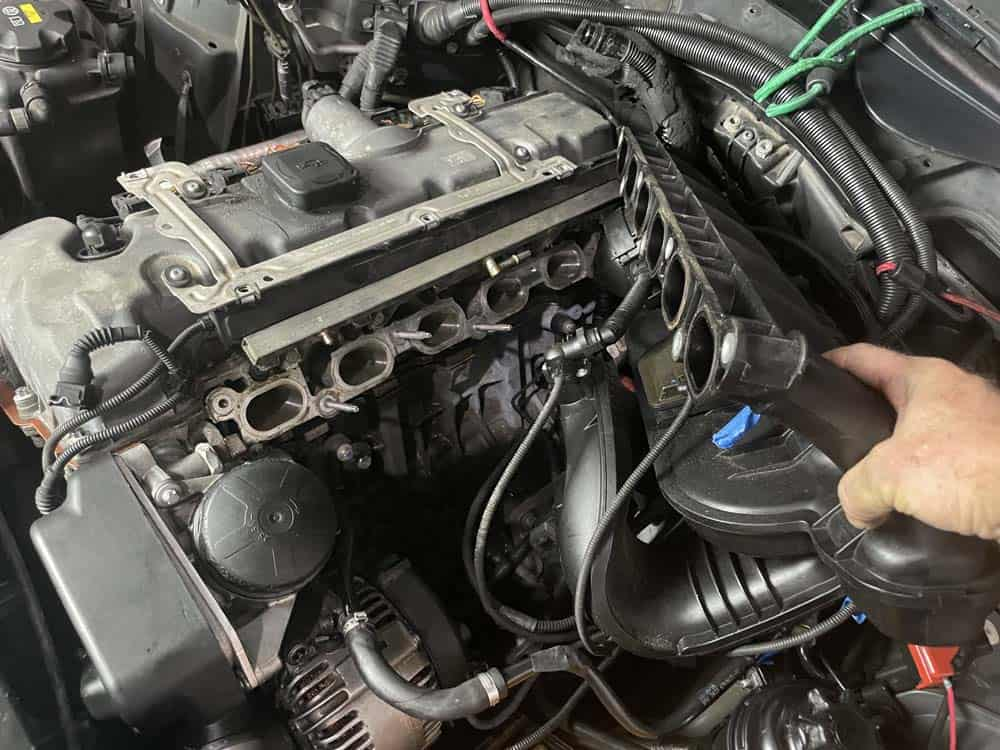 Pull the intake manifold loose from the cylinder head